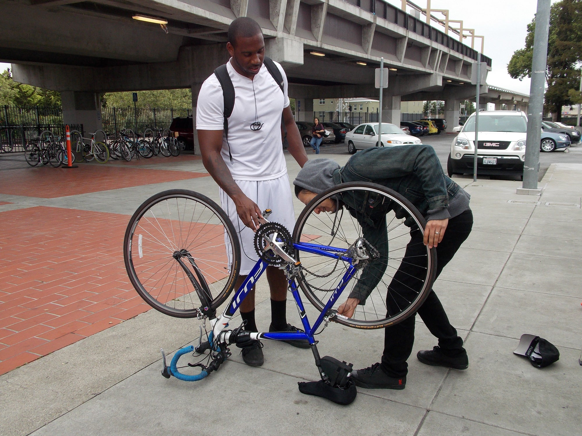 A commuter gets some tune up help at the Hayward BART station courtesy of Cyclepath Hayward.