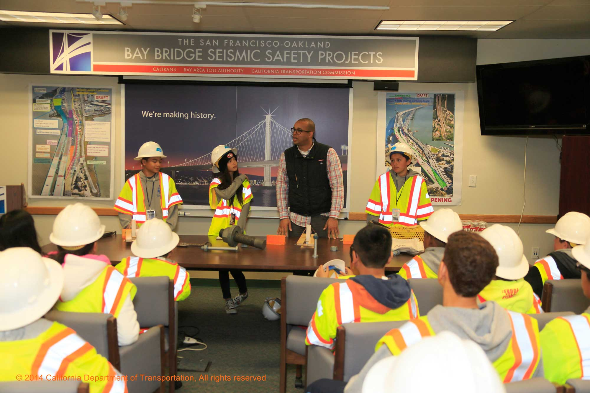 Public information officer Victor Gauthier quizzes the kids on Bay Bridge facts and figures.