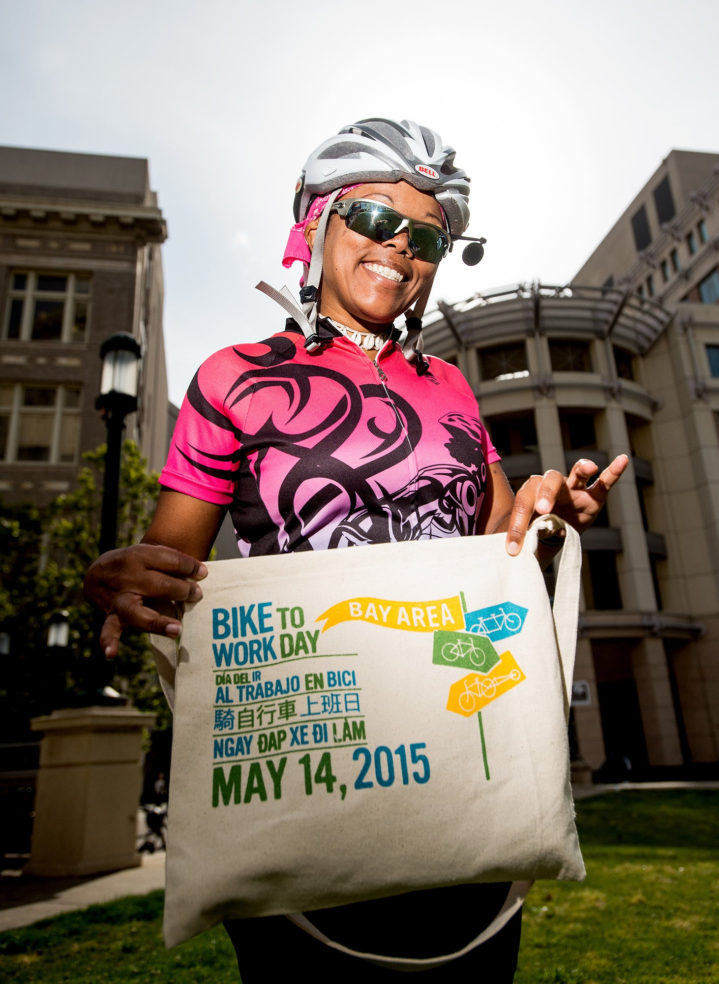 Oakland cyclist with official tote bag