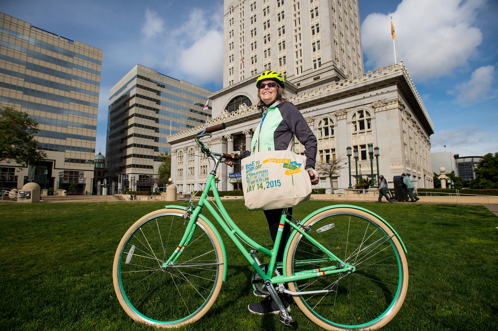 Gail Robinson poses with a Public bike she won on Bike to Work Day