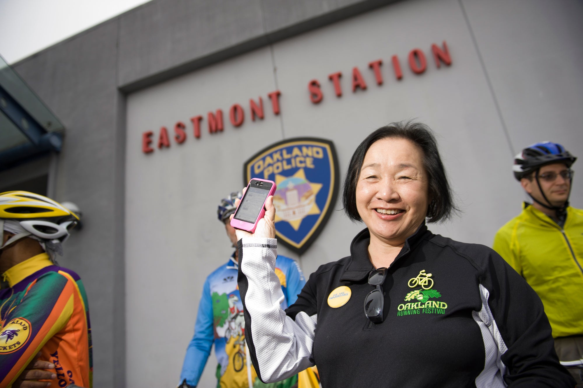 Oakland Mayor and MTC CommissionerJean Quan posts her bike to work day status to Facebook at the Eastmont Oakland Police Station.