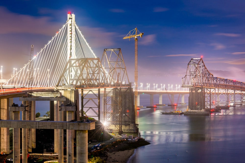 night shot of demolition of old East Span with Bay Lights