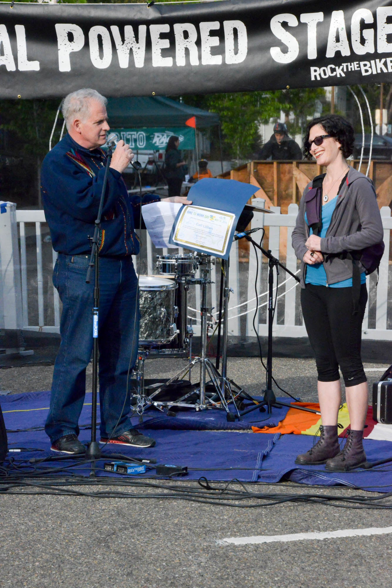 Berkeley City Councilmember Kriss Worthington presents a Bike East Bay Award to Gail Lillian