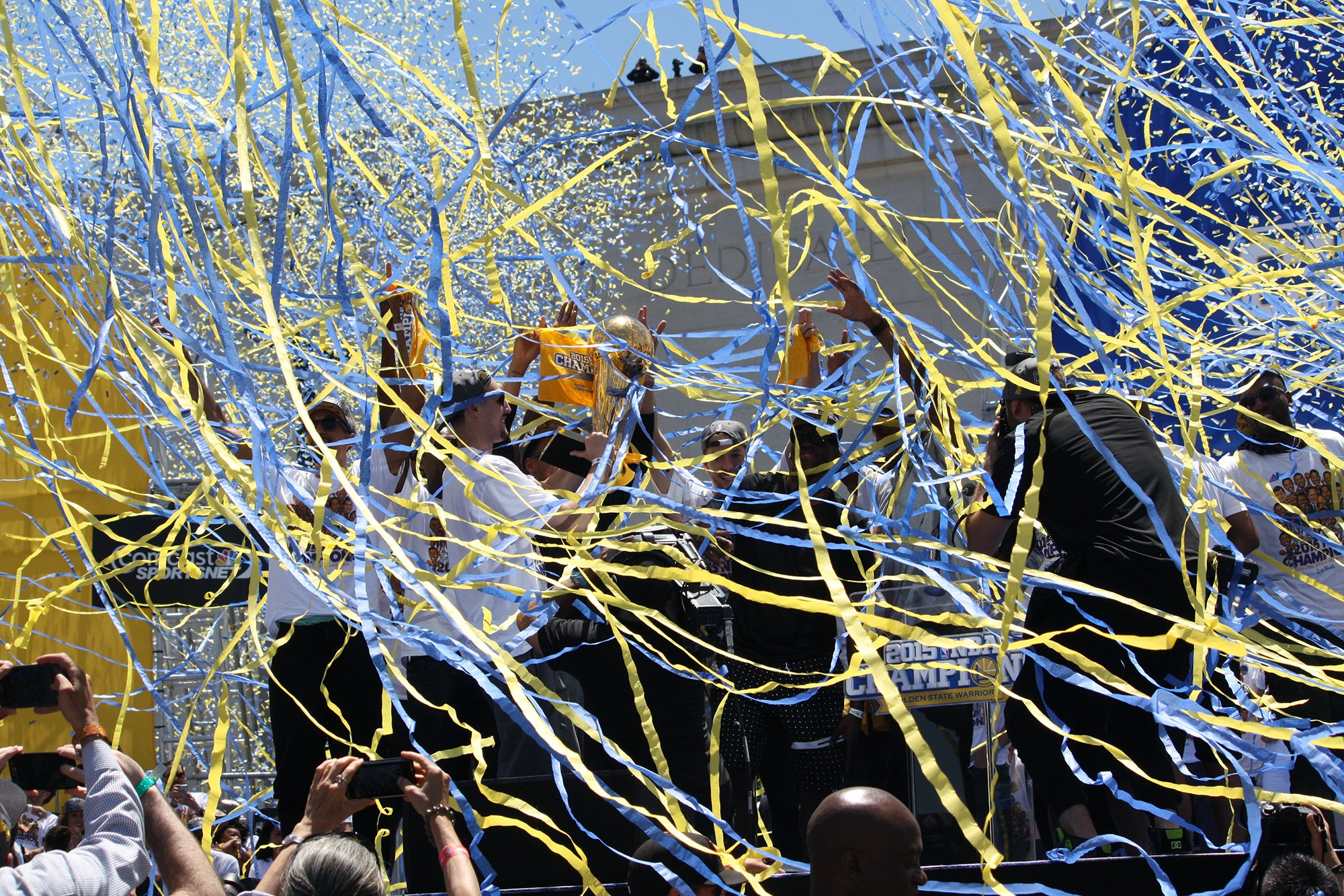 The confetti and streamers rain down on the players and officials on the stage.