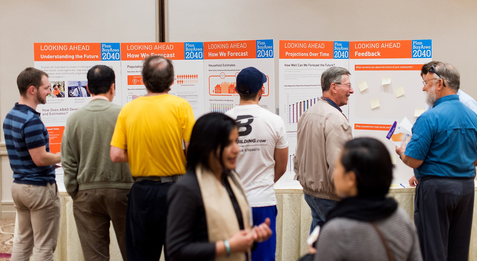 Members of the public examine the information displays