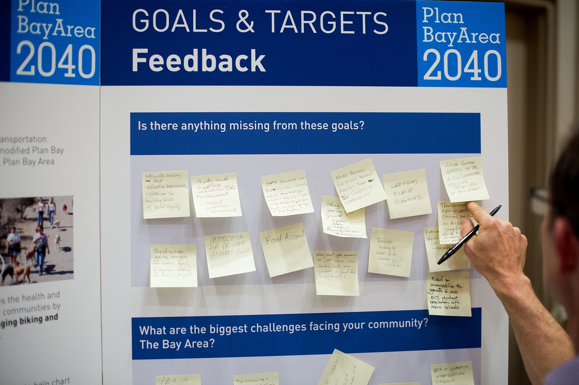 Participants pen ideas on sticky notes