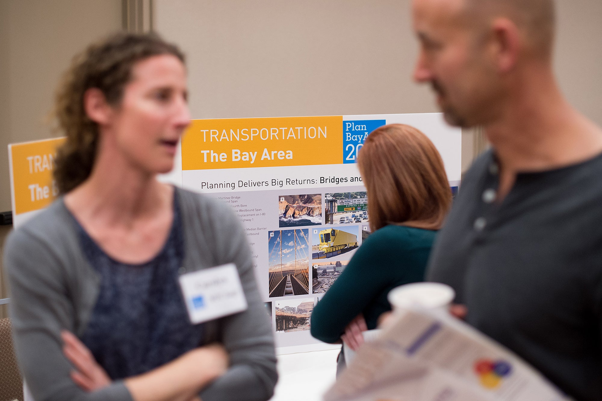 MTC staff member Carolyn Clevenger (left) speaks with an attendee.