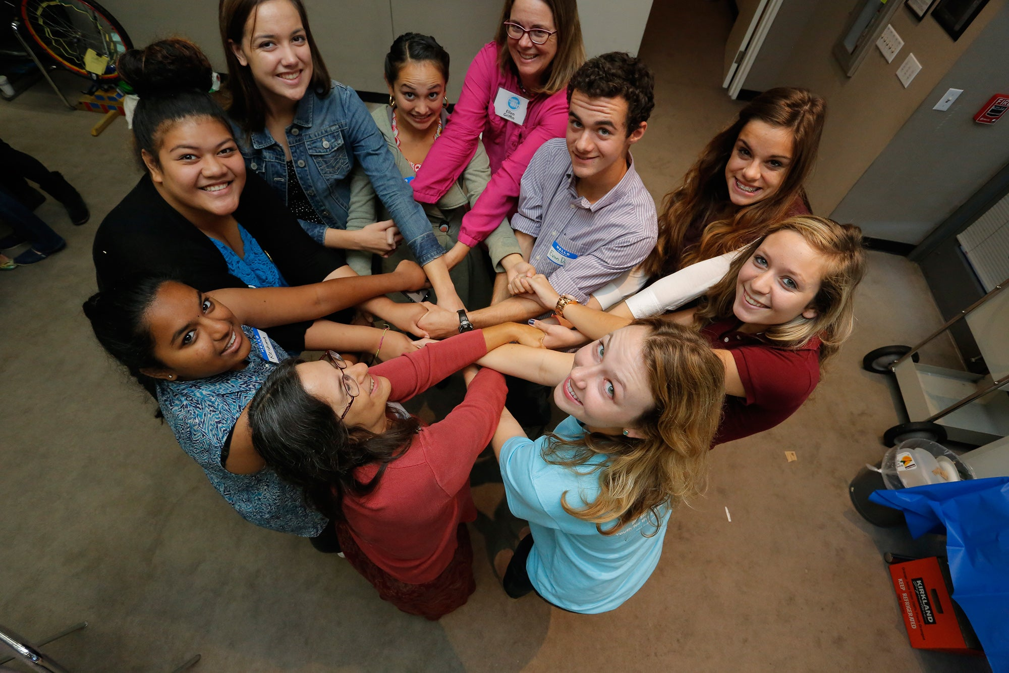 Students from all over the Bay Area get tangled in a human knot to kick off the conference.