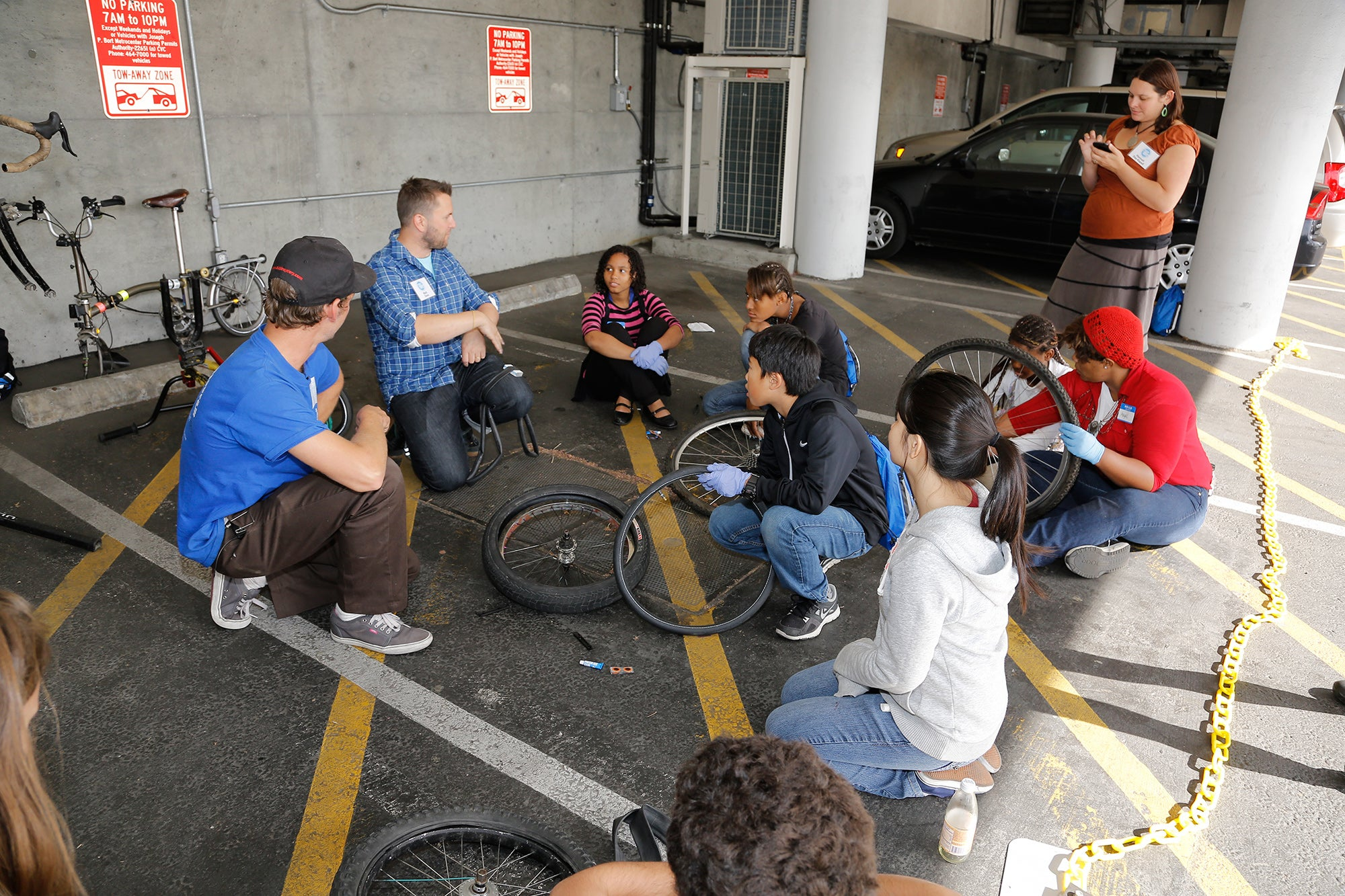 Students learn to fix their own flat tires at a bike repair break-out session.