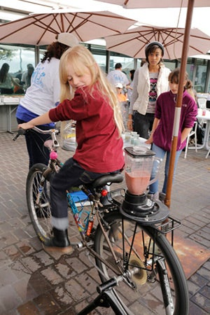 One student pedals her way to a smoothie, via YBike's bike blender.
