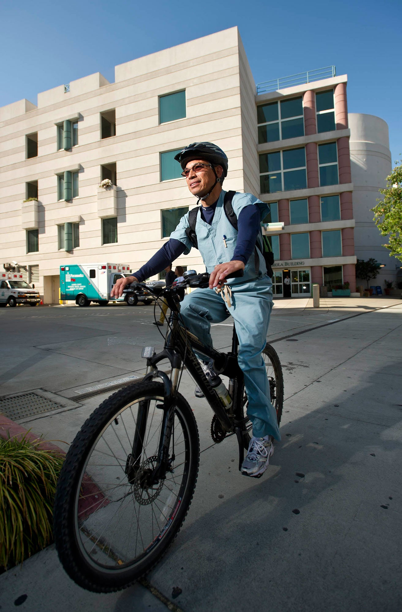 Saul Cristales, a worker in Kaiser Oakland's orthopedics department, rides home after a shift on BTWD. Cristales bikes round-trip from his El Cerrito home daily.
