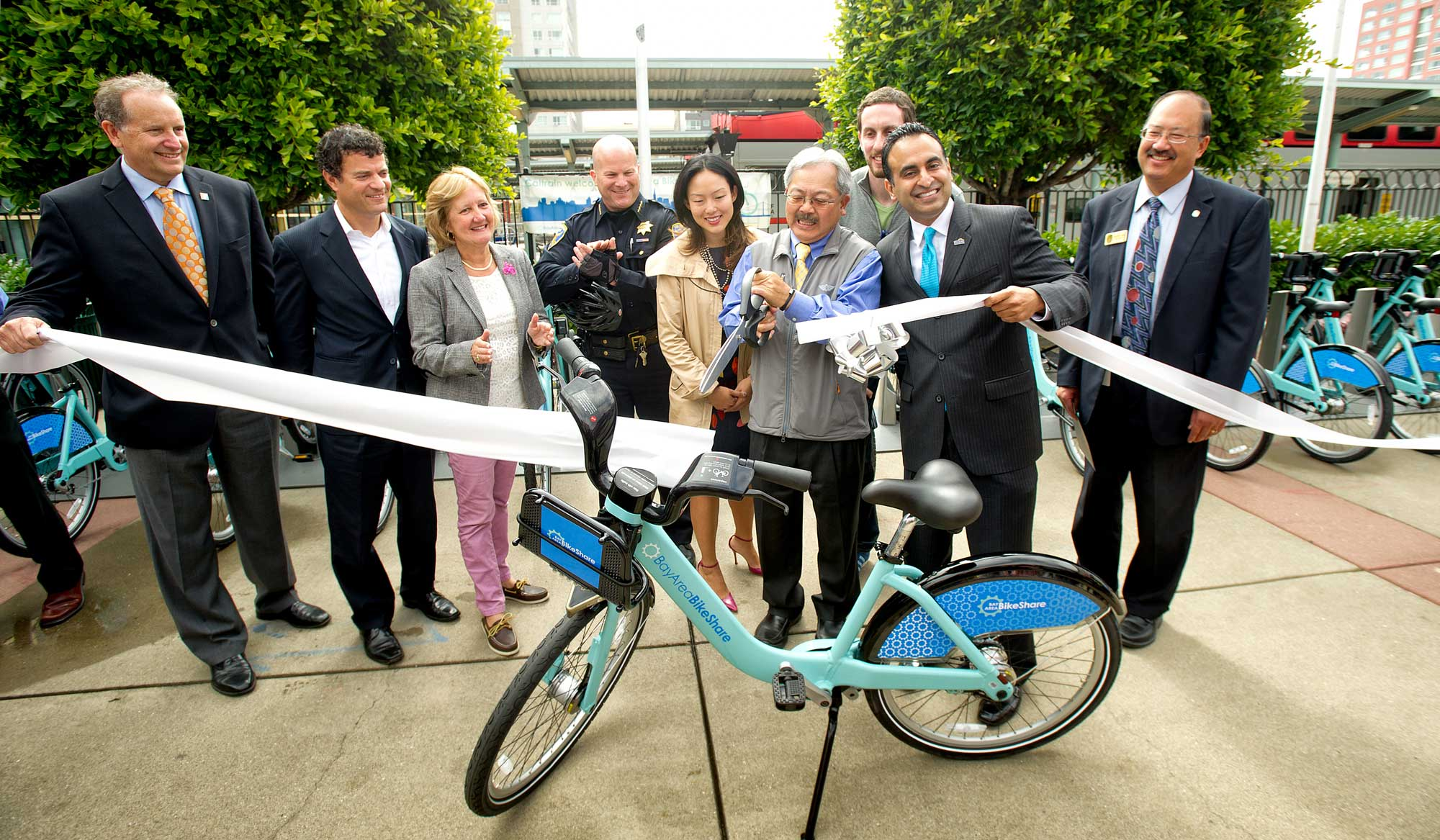 SF Mayor Ed Lee cuts the Bay Area BIke Share ribbon alongside MTC Commissioners Amy Worth and Scott Weiner.
