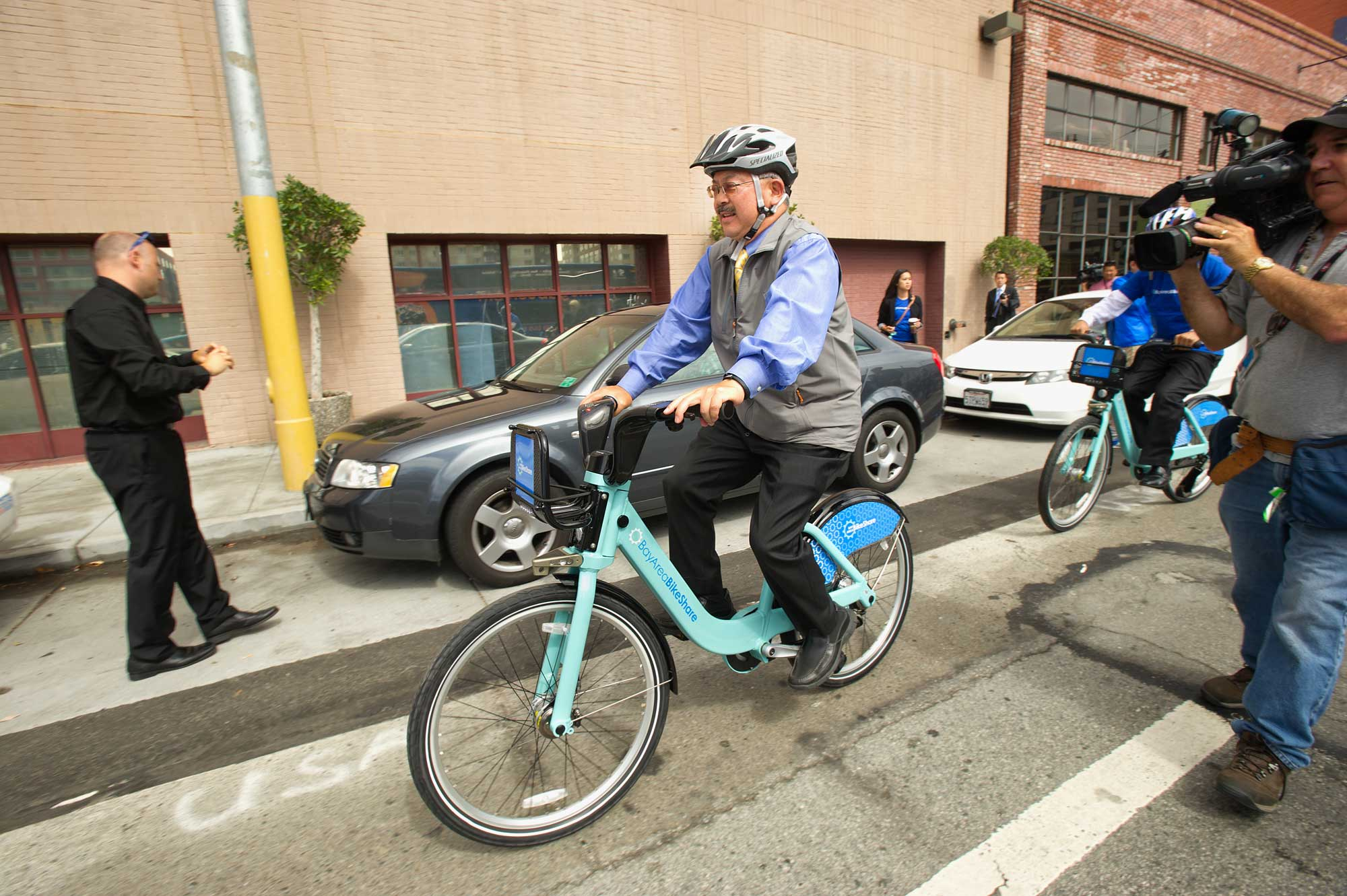 SF Mayor Ed Lee gives one of the bikes a whirl.