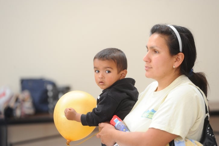 A member of the public with her child at an MTC meeting